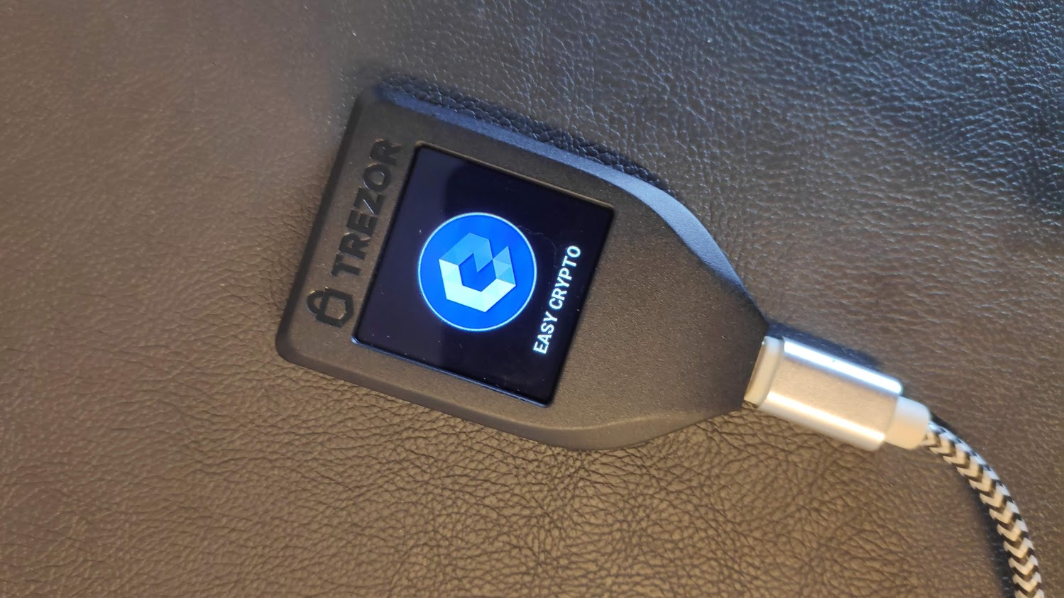 Photo of a Trezor Model T with the Easy Crypto Logo on the screen to illustrate one of the best bitcoin wallets in New Zealand