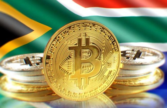 Bitcoin (BTC) is illustrated as physical gold coins with the national flag of South Africa on the background