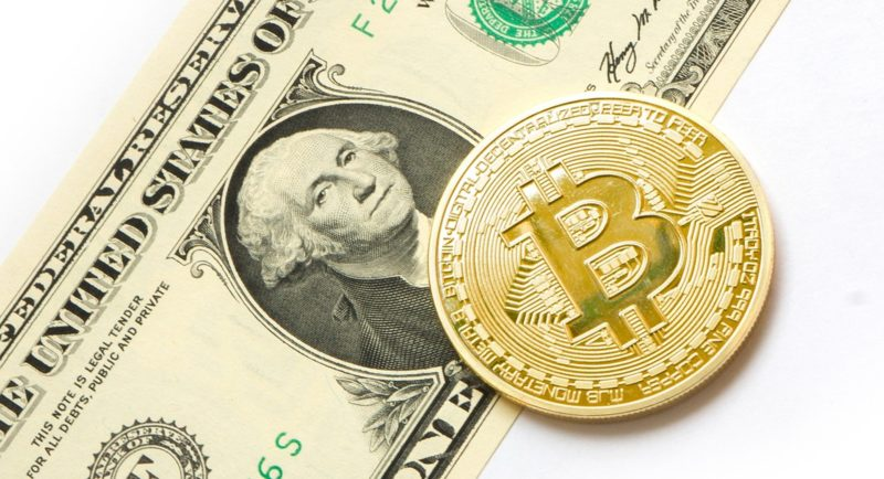 Bitcoin-BTC-on-top-of-USD-Bank-note-with-white-back-ground