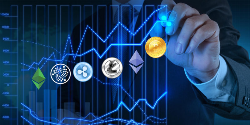 Ripple XRP coin logo with other cryptocurrencies on a graph being drawn by a suited man to represent XRP coin predictions
