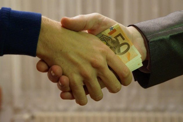 Close up shot of a handshake to illustrate choosing a secure crypto exchange to work with